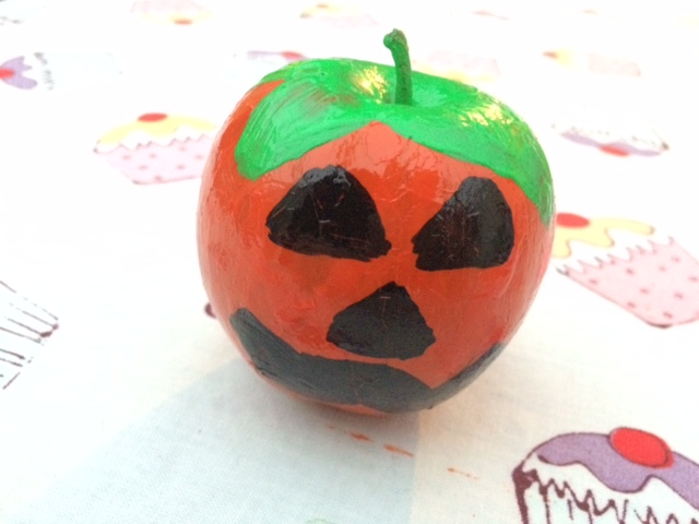 Apple painted as a pumpkin