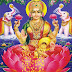 Goddess lakshmi devi seated and appeared with a lotus in her hand
