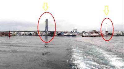 Pemandangan Menarik Jembatan Soekarno dan Tugu Lilin Kota Manado dari Laut