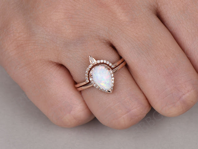 https://www.bbbgem.com/opal-crown-wedding-ring-set-6x8mm-pear-shape-14k-18k-rose-gold-opal-s001/#images-1