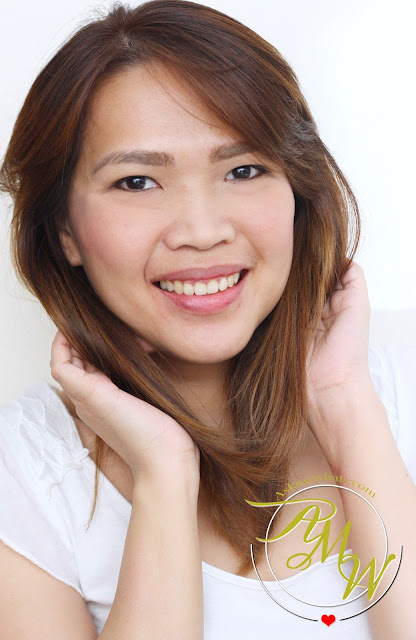 a photo of Nikki Tiu's AskMeWhats hair color L'Oreal Paris Excellence Fashion in 7.1 Beige Light Brown
