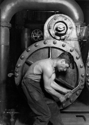 [1920 photo by Lewis Hine titled Power house mechanic working on steam pump.]