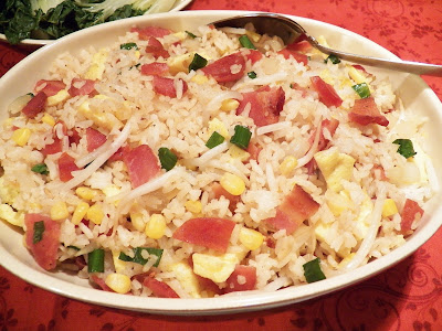 Bacon Egg and Sweet Sausage Fried Rice, an oval white bowl, red printed cloth surface.