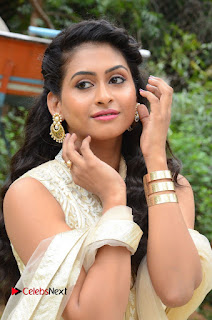 Actress Nithya Pictures in Long Dress at Nandini Nursing Home First Look Launch  0013.JPG