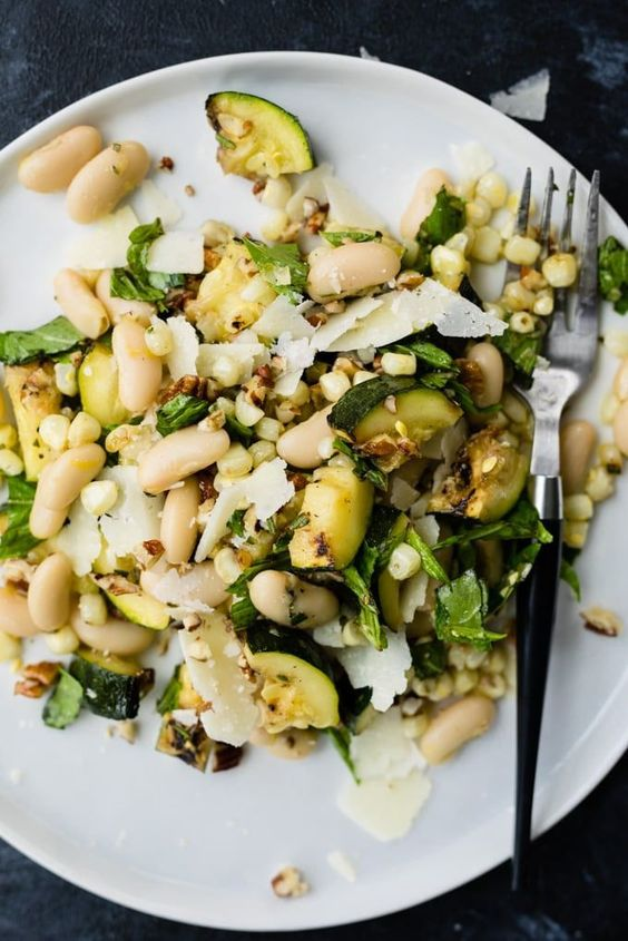 This grilled zucchini salad with corn and marinated white beans is a delicious summer dinner or side dish recipe that's as easy to eat as it is to make.