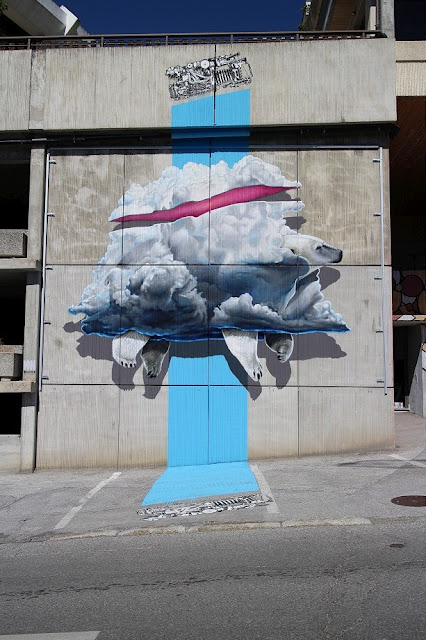 Art duo Never Crew also left their mark in Crans-Montana with their newest mural created for Vision Art Festival. Created on a 3 storey facade of a local parking garage, the piece is nicely blending with the environment it's placed in.