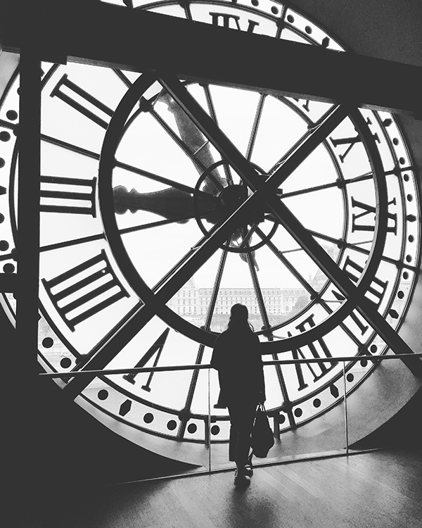 Standing in front of big clock at Musee d'Orsay, Paris