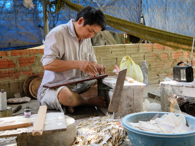 Artisan making mother-of-pearl inlays in Hoi An Vietnam