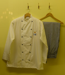 Uniform in the kitchen display in a Royal Welcome  2015 exhibition at Buckingham Palace  Photo © Andrew Knowles
