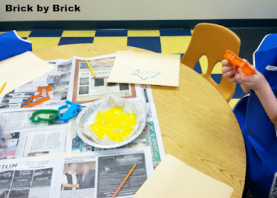 Painting with cookie cutters (Brick by Brick)