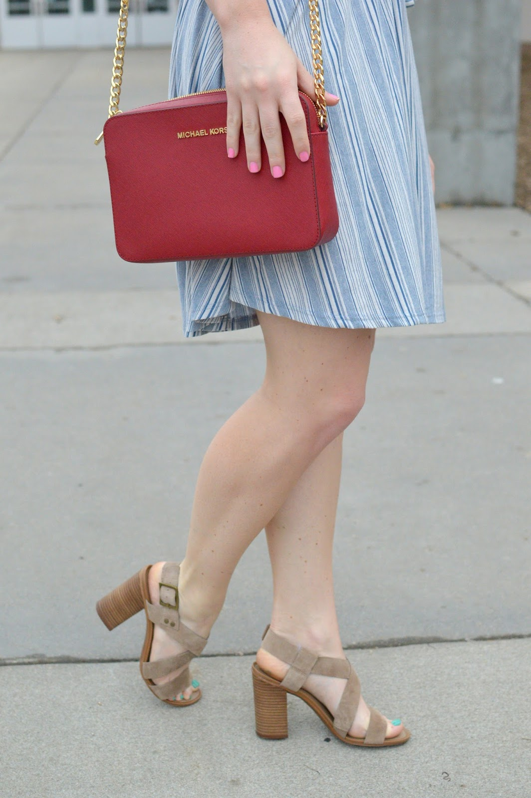 chunky heeled sandals and a red purse