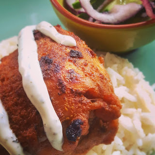 Indian Chicken on a bed of rice with Red Onion and Cucumber Salad