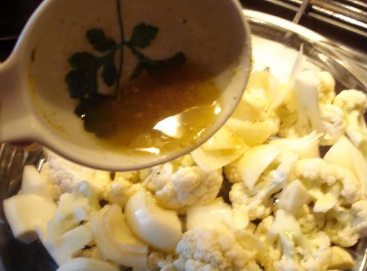 sprinkle oil mixture over cauliflower
