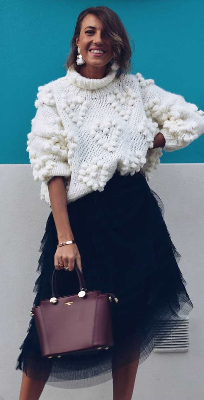 fashionable winter outfit / white knit sweater + black skirt + bag