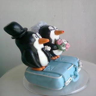 Topo de bolo casal de pinguins