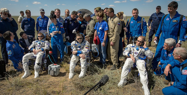 Tim Peake of the European Space Agency, left, Yuri Malenchenko of Roscosmos center, and Tim Kopra of NASA sit in chairs outside the Soyuz TMA-19M spacecraft just minutes after they landed in a remote area near the town of Zhezkazgan, Kazakhstan on Saturday, June 18, 2016. Kopra, Peake, and Malenchenko are returning after six months in space where they served as members of the Expedition 46 and 47 crews onboard the International Space Station. Photo Credit: (NASA/Bill Ingalls)