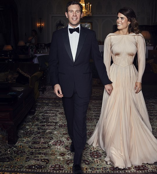 Princess Eugenie's evening dress was designed by Zac Posen, she is wearing diamond and emerald drop earrings. Princess Charlotte