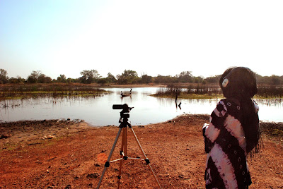 Workshop participant, Khardiata Bodian, records sound at the river in Karcia on the final day of shooting.