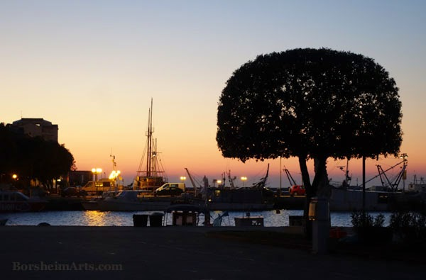 sunset over harbor in Umag, Croatia; peaceful colors