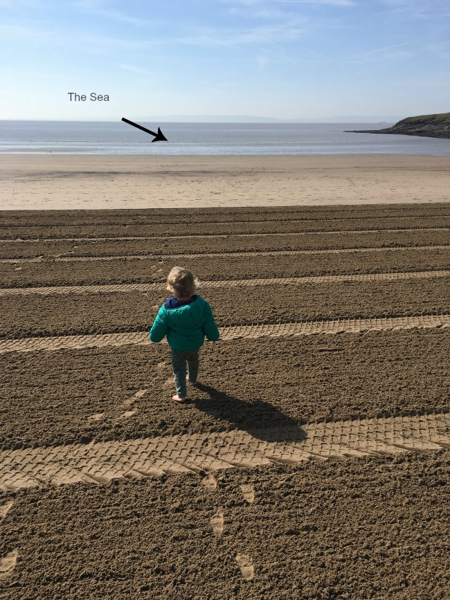 Sea And Sand - Barry Island Toddler on beach, sea long way away