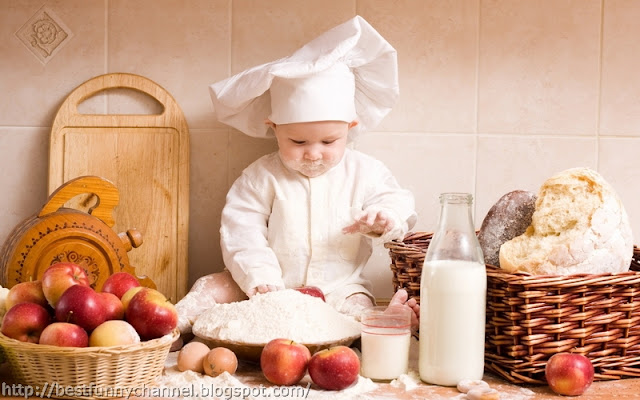 Baby dressed as a cook.