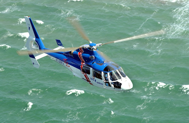 Eurocopter AS-365 Dauphin Cruising Over Ocean