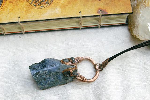 https://www.etsy.com/ca/listing/658184388/raw-sodalite-pendant-polished-iolite