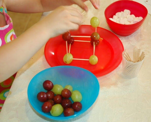 Construction week snack, building with grapes, marshmallows, and toothpicks