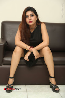 Tollywood Upcoming Actress Pooja Roshan Stills in Black Short Dress at Plus 1 Movie Trailer Launch  0299.JPG