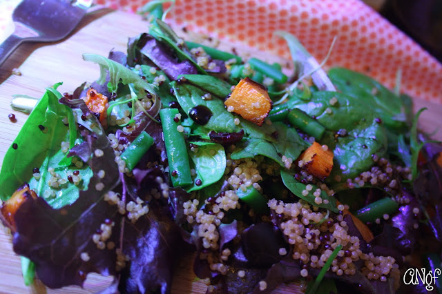 This warm gluten free butternut squash and quinoa salad is served on a bed of leaves with green beans and dried blueberry-infused cranberries. | Anyonita-nibbles.co.uk