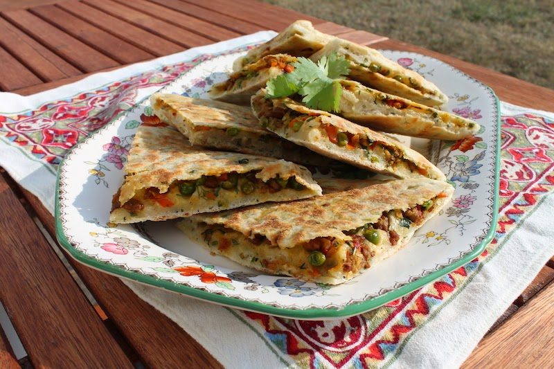 Food Lust People Love: Keema Naan - spicy lamb cooked with peas and carrots stuffed into soft dough and cooked in a non-stick pan - makes a wonderful starter or can even star in a meal rounded out by a crunchy side salad or cucumber raita.