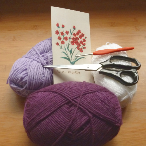 purple lilac and white yarn scissors card and crochet hook