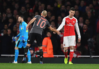 Bayern Captain Arjen Robben Greets  Arsenal captain Per Mertesacker after a huge arsenal loss and defeat. 1-5 at Emirates. PHOTO | Courtesy