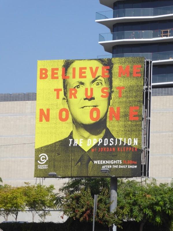 Opposition Believe me Trust no one billboard