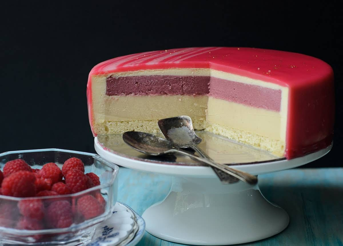 Sliced Mirror glazed Honey, Raspberry and White Chocolate Bavarois entremet photo