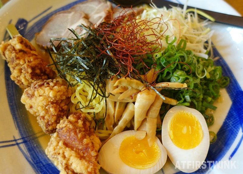 Takumi Düsseldorf Rotterdam May special Tokyo Style noodle karaage fried chicken cha siu spring onions bamboo shoots nori saffron soft boiled egg shoyu sauce close up
