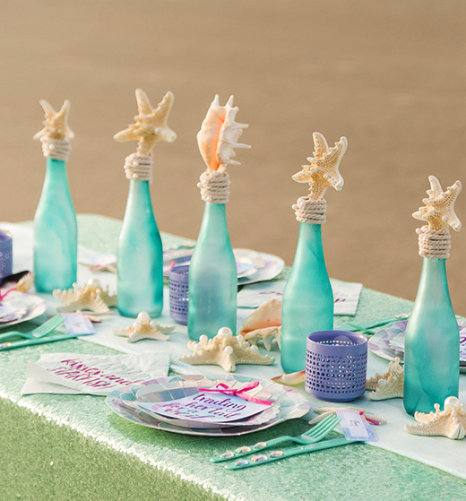 Frosted Seaglass Bottles Topped with Shells Tabletop Decor Idea