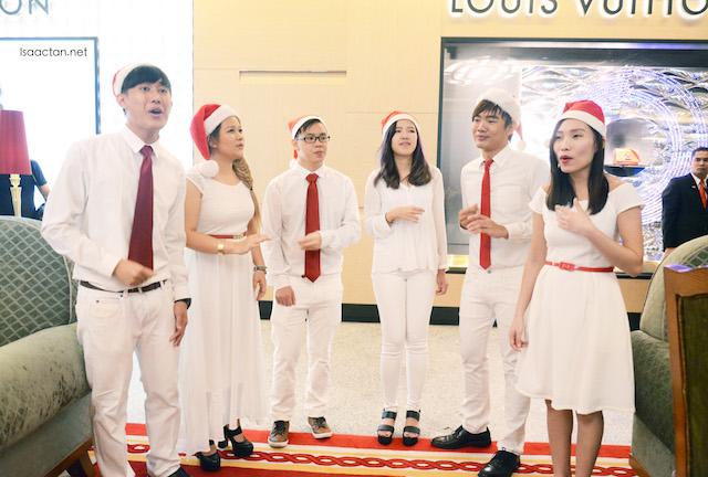 Christmas carollers singing along