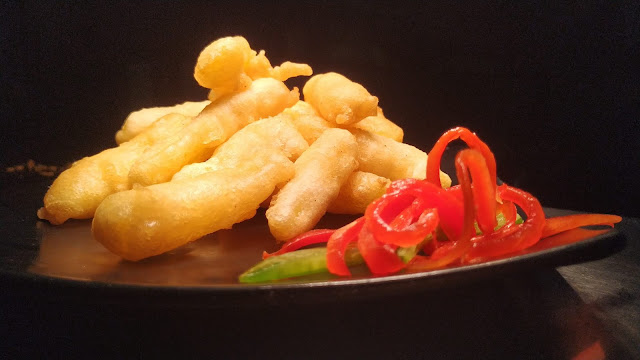 Golden fried pineapple fingers with garnished plate dinner ideas Food Recipe