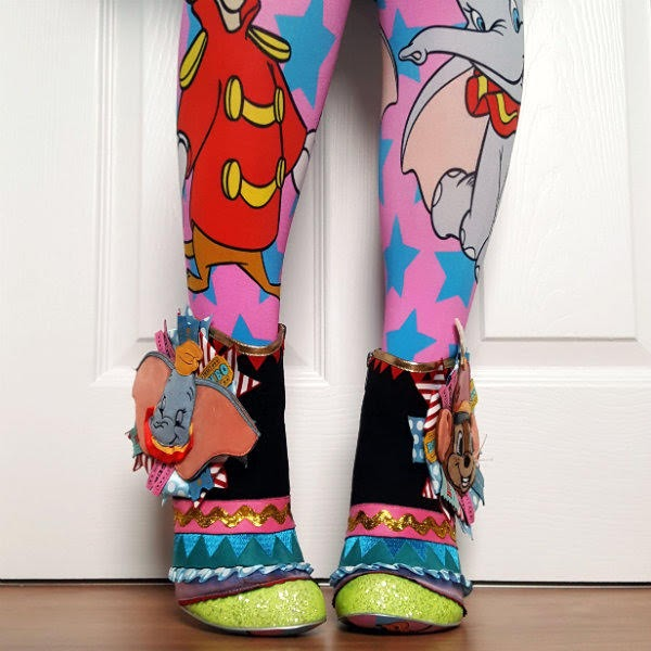 wearing Disney Dumbo bright tights and Dumbo ankle boots