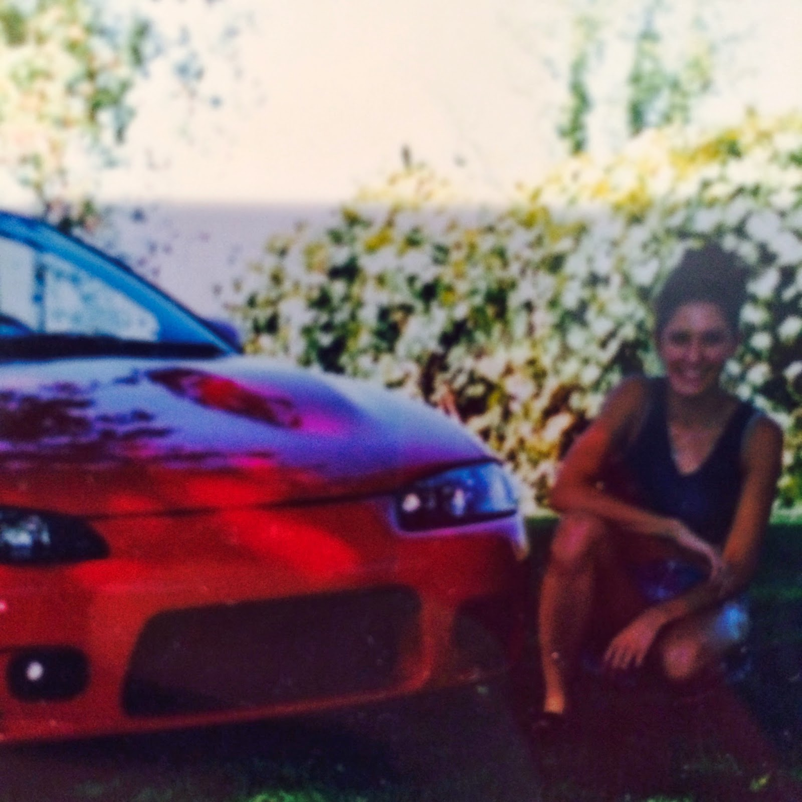 1998 Mitsubishi Eclipse and a girl.