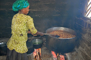 Stewing food on a wooden stove in Southern Africa.