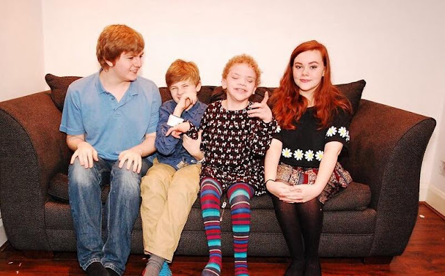 picture of Theo, Jules, Daisy and Xanthe sat together on the sofa