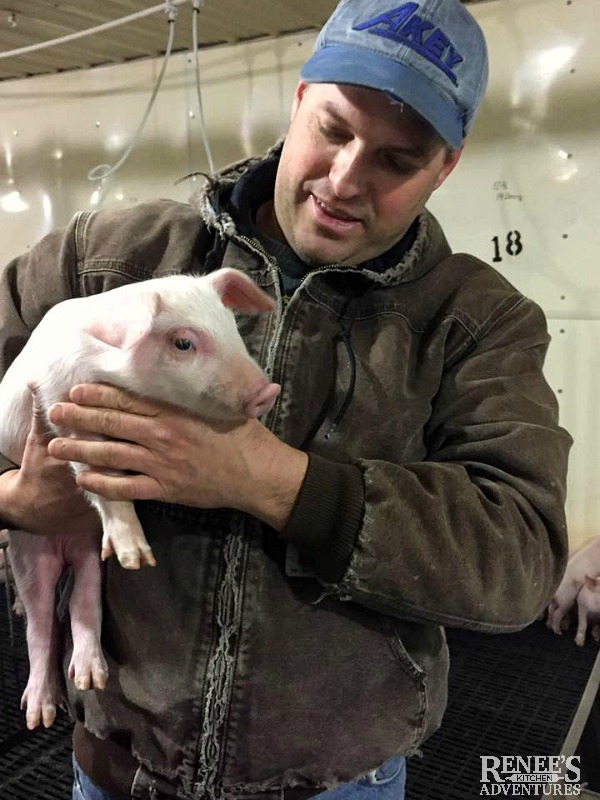 Don Shoup from Shoup Brothers Farm holding a pig