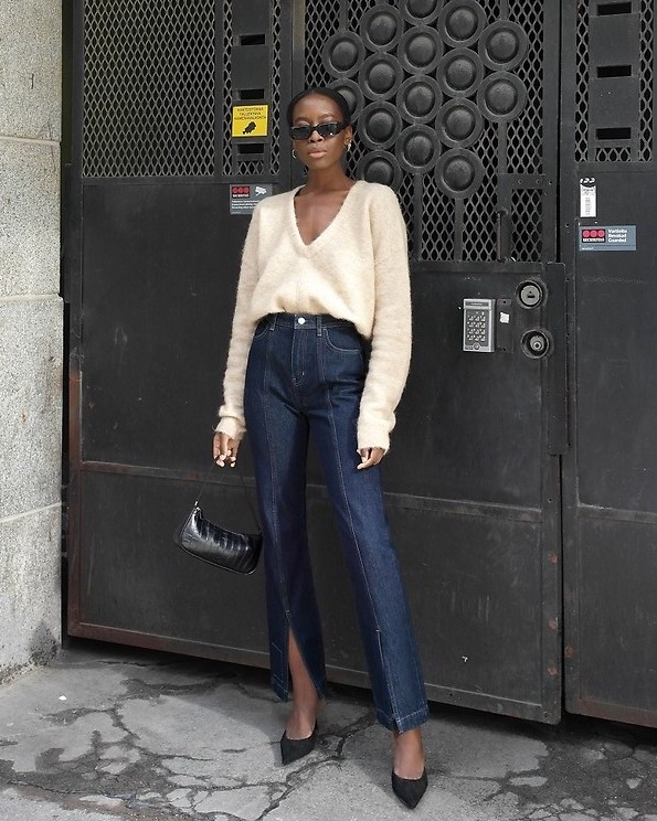 This Stylish Scandi-Girl Outfit Is Perfect for Spring — Sylvie Mus in a v-neck sweater, '90s shoulder bag, split-hem jeans, and black suede pumps