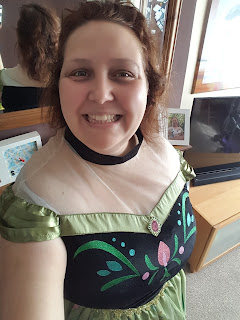 PippaD dressed up in her Anna Costume to do the household chores