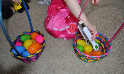 Build fine motor skills by using tongs and plastic Easter eggs