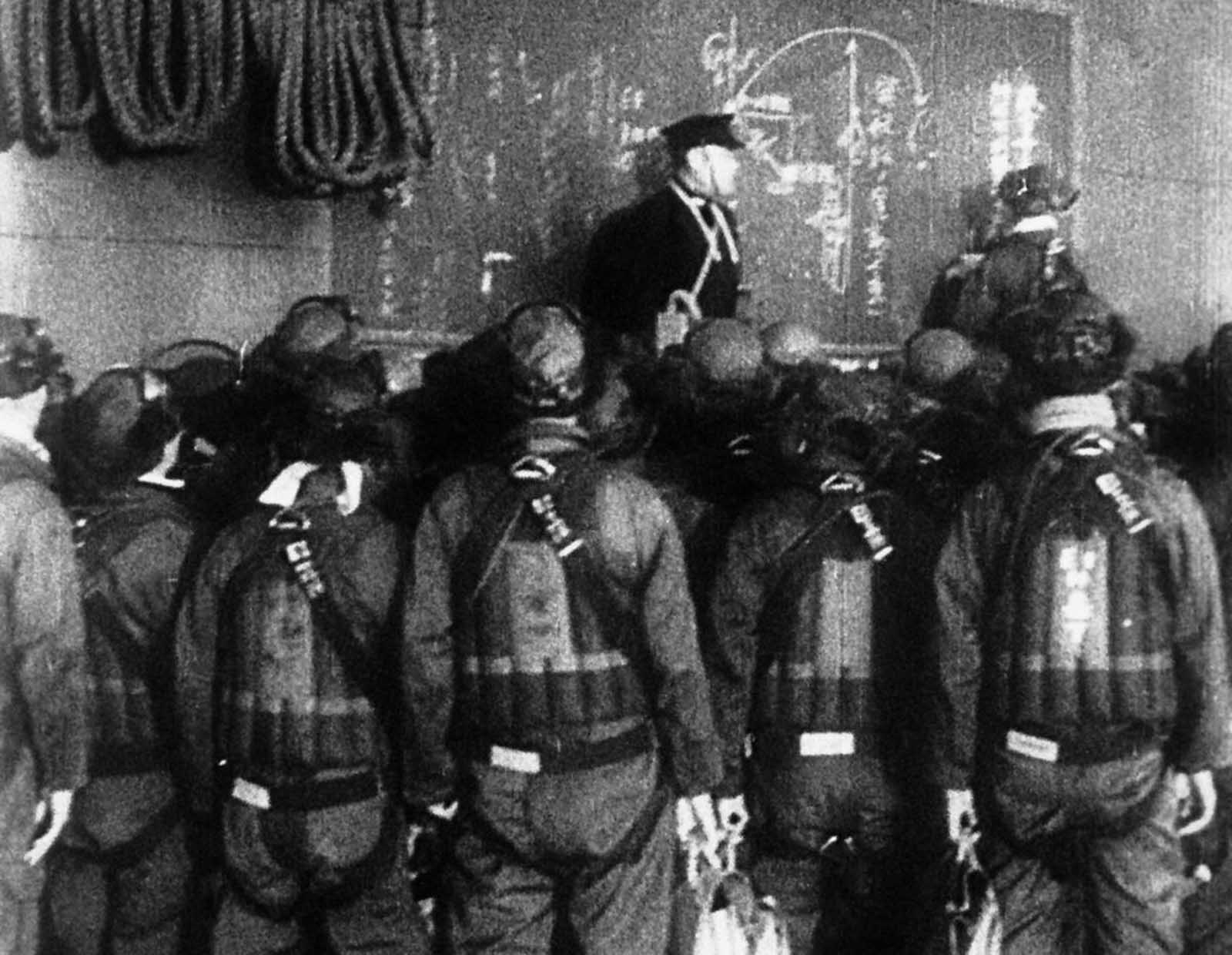 Japanese pilots get instructions aboard an aircraft carrier before the attack on Pearl Harbor, in this scene from a Japanese newsreel. It was obtained by the U.S. War Department and released to U.S. newsreels.