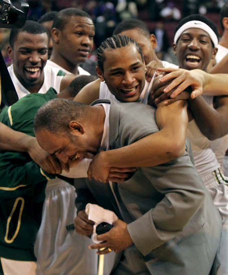 ae17bac67e91 Players congratulate Coach Dru Joyce (Photo by Phil Masturzo Akron Beacon  Journal)