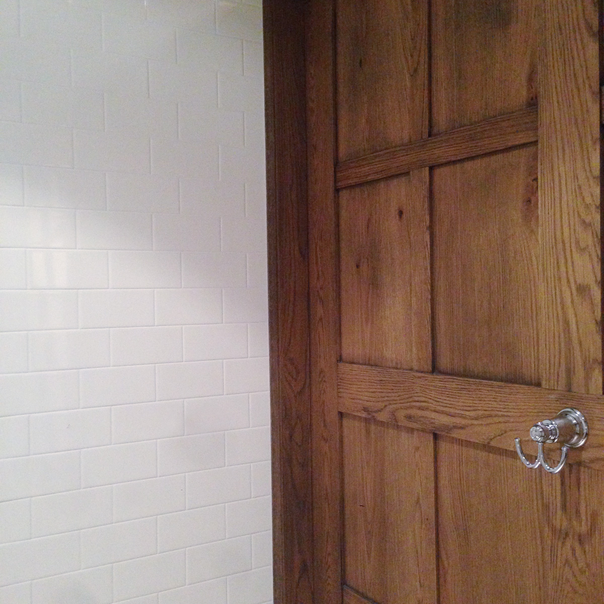 French bistro style, wood panelling, subway tile wall